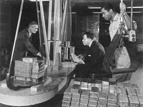 1965: Bars of gold being weighed and earmarked for international exchange transactions in the top security vaults of New York's Federal Reserve Bank.