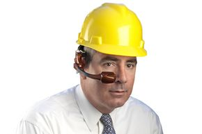 It fits snuggly under a typical helmet, and it looks snappy with a suit. But make sure your tie choice fits the color scheme of your Golden-i computer.