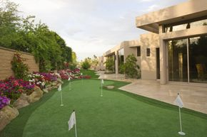 This backyard golf green in Palm Springs allows the owners to practice golf whenever they want. See pictures of incredible homes of the future.