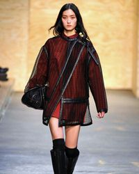 This coat from the Proenza Schouler runway show offers Asian influences in its design.