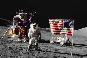 Pilot Harrison H Schmitt stands on the lunar surface near the U. S. flag during NASA's lunar landing in 1972. Some conspiracy theorists think all moon landings were faked because a flag couldn't wave in a windless place.