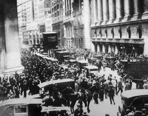 Panicked New Yorkers flood Wall Street during the stock market crash on Oct. 29, 1929. See more recession pictures.