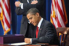 On Feb. 17, 2009 in Denver, President Obama signed the $787 billion economic stimulus bill that helped increase unemployment benefits and provide grants for job retraining programs.