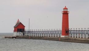 Positioned as it is far from shore, the Grand Haven lighthouse is visible far out on the lake, warning mariners of shallow waters close to shore. See more lighthouse pictures.