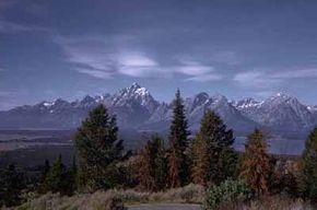 National Parks Image Gallery Carved by glacial ice thousands of years ago, the Tetons' sheer-walled canyons still harbor snowfields and several small glaciers. See more pictures of national parks.