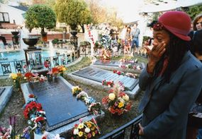 Mourners are allowed to visit The King's grave site in the meditiation garden for free each morning.