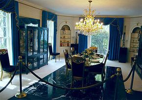 The floor of Graceland's dining room is black marble and white carpet.