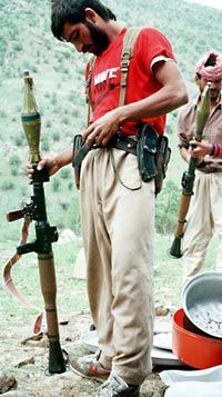 A Kurdish refugee with a Soviet RPG-7 grenade launcher, a common weapon in smaller armies and resistance forces