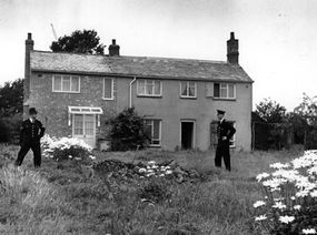 Police guard Leatherslade Farm at Oakley in Buckinghamshire. The farm was used as a safe house by the Great Train Robbers.
