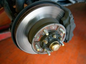 Grease caps, like the one at the center of this wheel hub, keep wheel bearing grease free from contamination.
