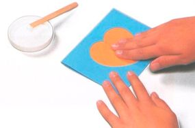 Glue the shape onto the front of the card.