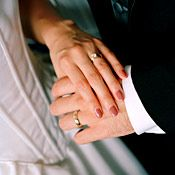 Joining hands is a common Greek wedding tradition.