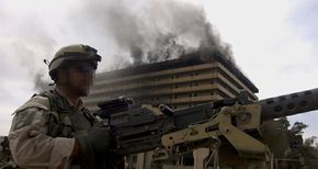"""Green Berets, like this solider shown in downtown Baghdad in 2003, are trained to serve as """"warrior-diplomats."""""""