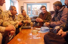 Green Berets take part in a meeting with local leaders as part of a Civil Affairs operation in Afghanistan.