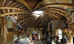 A cozy cob house.  Note the built-in shelves and nooks.
