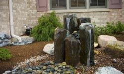 Would you believe there's rainwater harvesting system amid these fountain rocks?  Sure beats a plastic barrel.