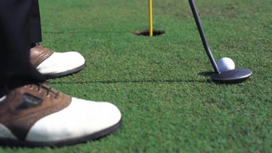 How can the grass on the greens at a golf course be so perfect?