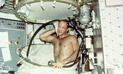 Skylab 3 pilot Jack R. Lousma takes a hot bath. This water would need to be recycled for further use to conserve resources and storage space.
