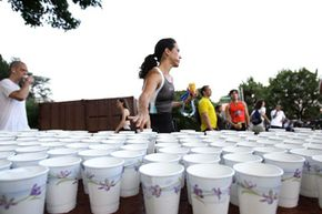 """Empty water cups are just some of the waste organizers of """"green"""" triathlons are trying to reduce."""