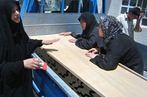 Iraqi women, dressed in black, grieve for a relative whose body was found just outside Baquba in June 2008. See more emotion pictures.