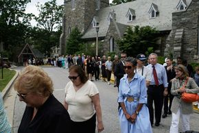 The general public lines up to pay tribute to the late television newsman Tim Russert in June 2008. Russert's unexpected death of a heart attack is the kind of traumatic death that may bring on complicated grief.