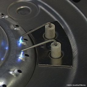 Turning the knob on this grill causes the spark to jump between the two electrodes.