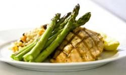 Chicken, asparegus and rice pilaf on plate
