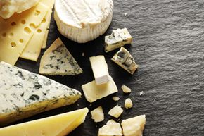 Bringing gifts to a baby shower is pretty mandatory, but most modern moms won't be expecting a huge wheel of brie on their big day.