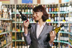 Dropping one of those bottles will be enough to snap her out of that wine-related reverie.