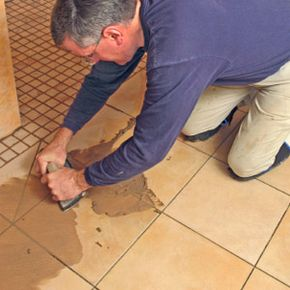 Kneepads are a handy accessory when grouting floor tile.