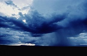 Water vapor that ends up in clouds eventually condenses into water droplets and precipitates as rain, sleet, hail or snow.