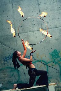 Edmonton, Alberta-based fire dancer SaFire brandishes a fire hoop.