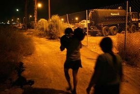 Migrants retreat to Mexico during a failed attempt to illegally enter the United States.