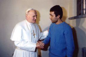 Pope John Paul II meeting with Mehmet Ali Agca at Rebibbia prison in Rome on December 27, 1983.