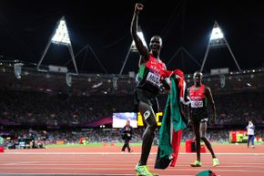 Abel Kiprop Mutai of Kenya celebrating his bronze medal run after the Men's 3000m Steeplechase on August 5, 2012 at the London 2012 Olympic Games.