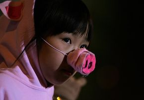 While we won't see any human-pig hybrids roaming the streets, this little girl in San Francisco doesn't mind dressing up as one to celebrate the Chinese New Year.