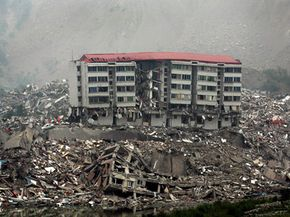 Rescue workers search for survivors among the debris of collapsed buildings in Beichuan County, in southwest China's Sichuan province. See more pictures of natural disasters.