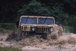 Image Gallery: Off-roading Civilian or commercial Humvees can navigate through 36 inches of water without a problem. See more off-roading pictures.