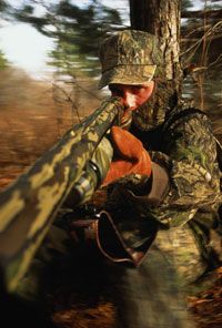 A turkey hunter searches for prey. Could you see this guy from 50 feet away?