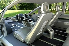 The Hy-wire has wheels, seats and windows like a conventional car, but the similarity pretty much ends there. There is no engine under the hood and no steering wheel or pedals inside.