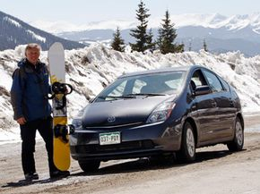 Hybrid Car Image Gallery Kim Fenske, of Copper Mountain, Colo., poses for a photo beside his 2008 Toyota Prius sedan before he sets out for a day in the snow. See more pictures of hybrid cars.