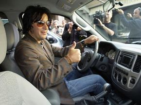 Musician Rami Jafee prepares to test drive the Ford Escape Hybrid SUV. Hybrid system indicators keep drivers of hybrid cars in the know about their fuel efficiency and driving habits.