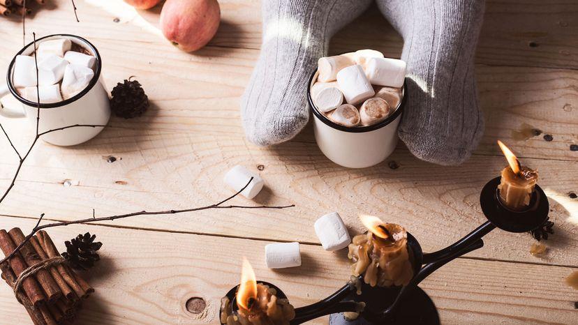 woolly socks, candles and a mug of cocoa.