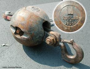The large metal ball attached to the hook keeps the cable taut when there is no load on the hook.