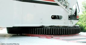 The large gear under the cab is the Rotex gear, which allows the cab to swivel and move the boom from side to side.
