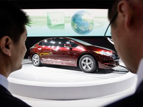 Visitors look at the Honda FCX Clarity at the Auto China 2008 auto show in Beijing, on April 20, 2008.