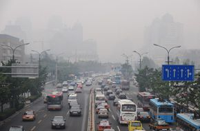 Afternoon traffic flows along smog-filled Beijing streets on July 14, 2008. Is it possible for vehicles powered by hydrogen fuel cells to reduce the pollution in the air?