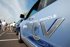 A new hydrogen-powered vehicle by Nissan is displayed during a Hydrogen Ride and Drive event at the Liberty Science Center August 13, 2008 in Jersey City, N. J.