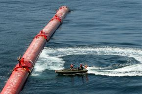 An electricity generator based on wave power sits off of Portugal's coast in 2008. A technical glitch forced the wave energy farm offline after two months. It used floating tubes whose bobbing motion pumped hydraulic fluid to drive generators.