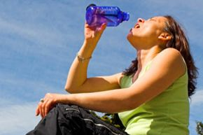 Hyponatremia's milder symptoms include nausea, vomiting, and muscle cramps and spasms. The danger is that these are similar to the symptoms of dehydration, and if you misdiagnose yourself and start drinking more fluids, you'll make the problem more serious.